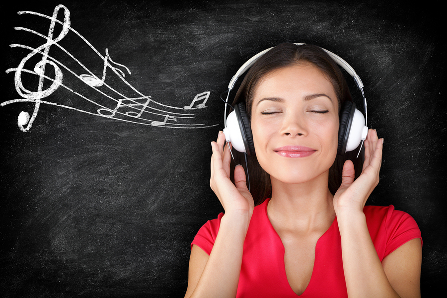 Music - woman wearing headphones listening to music with music n